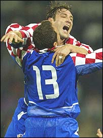 Croatia celebrate after their victory over Slovenia