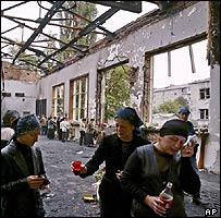 Mourners in gutted Beslan school