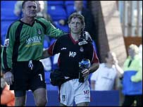 Andy Dibble is led off against Tranmere (SportPixs)