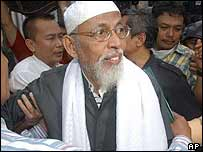 Abu Bakar Ba'asyir is being escorted from prison after being re-arrested in April