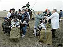 Astronauts are being checked by medics after landing in Kazakhstan