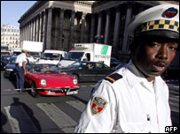 A French policeman ensures drivers comply with car-free day