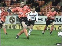 Mark Wilson scores from the spot against Clyde