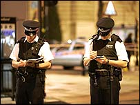 Police officers making notes