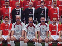 Charlton wearing blue moustaches for charity