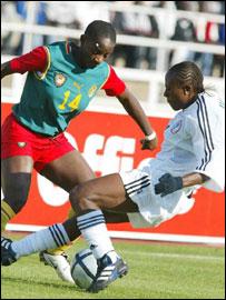 Cynthia Uwak tackles Cameroon's Manuella Bekombo