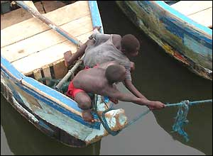 Boys gather boats in Ghana