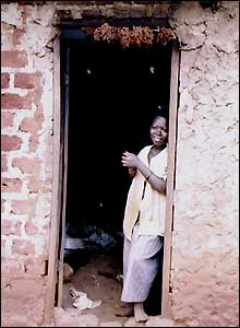 A woman in a doorway in Uganda