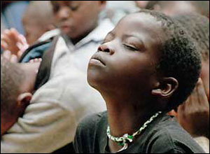 An orphan in Malawi praying