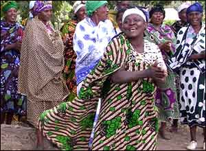 Tanzanian women ululate with joy