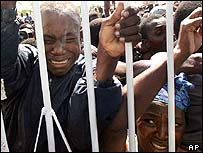 Displaced people waiting to receive food and water in Gonaives, Haiti.