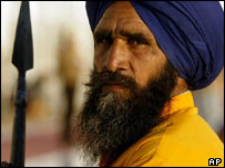 Employee at a Sikh shrine