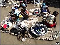 Haitians take refuge on a piece of high ground in Gonaives