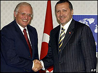 Guenter Verheugen, the European Union's Enlargement Commissioner (left), and Turkish Prime Minister Recep Tayyip Erdogan,