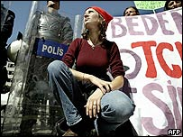 A woman demonstrates against a Turkish proposed ban on adultery