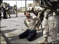 US soldiers detain a man in Iraq