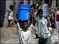 Boys carry water in Haiti