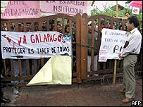 Galapagos park wardens block the path of director Cepeda