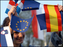 A Polish girl waves EU flags during an EU enlargement party in Zittau