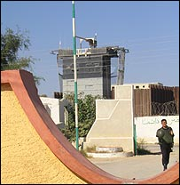 Egypt-Gaza crossing, with Israeli watch tower in the background
