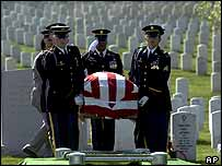 Flag-draped coffin of Army Sgt Major Michael B Stack is saluted as it is carried by an honour guard during burial services at Arlington National Cemetery in Arlington, Virginia