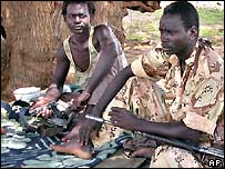 Sudan Liberation Army rebels sit under a tree in Darfur