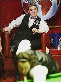 Stephen Hendry watches Ronnie O'Sullivan during the World Championship semi-final