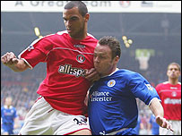 Jonathan Fortune and Paul Dickov do battle