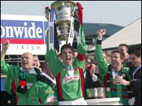 Paul Leeman holds the cup aloft