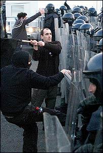 Dublin protesters confront riot police