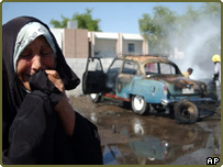 Woman cries by scene of suicide car bombing in Iraq