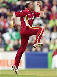 Dwayne Bravo celebrates running out Yasir Hameed in the Champions Trophy semi-final