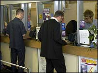 People at a Post Office counter