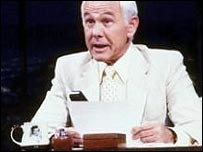 Johnny Carson at his desk on the Tonight Show