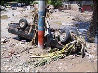 An upturned car in Gonaives, Haiti