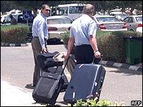 Two British men leave a hotel in Yanbu, Saudi Arabia