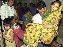 Injured garment worker being carried for treatment in Dhaka