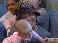 Dame Shirley Bassey holding baby Leora Johns