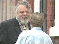 Terry Waite greets one of Mr Bigley's brothers outside the house