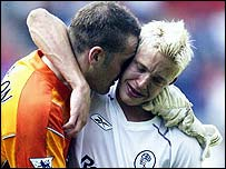 Leeds striker Alan Smith and goalkeeper Paul Robinson console each other after the club's relegation is confirmed
