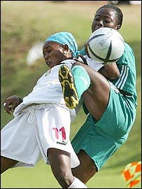 Mail's Rokiatou Samake and Nigeria's Bunmi Kayode tussel for the ball