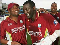 Brian Lara celebrates with match-winner Courtney Browne