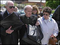 The Rev. Gerald Robinson (centre) - flanked by supporters - walks away from the Lucas County Corrections Center in Toledo