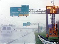 Cars drive north on Interstate highway 95 after the first bands of Hurricane Jeanne came ashore in Boynton Beach, Florida