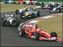 Rubens Barrichello leads Kimi Raikkonen, Fernando Alonso and Jenson Button at the start of the Chinese Grand Prix