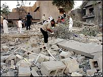 Residents pick through the rubble of a house destroyed in Falluja