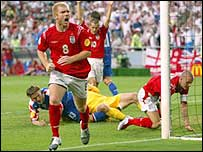 Paul Scholes celebrates scoring against Croatia at Euro 2004