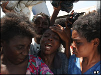 Haitian women scramble for food in Gonaives, Haiti