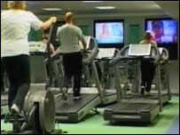 Working out at a private health club