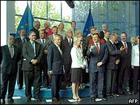 EU commissioners-designate stand together with European Commission President  Jose Manuel Durao Barroso (3rd left in front row)